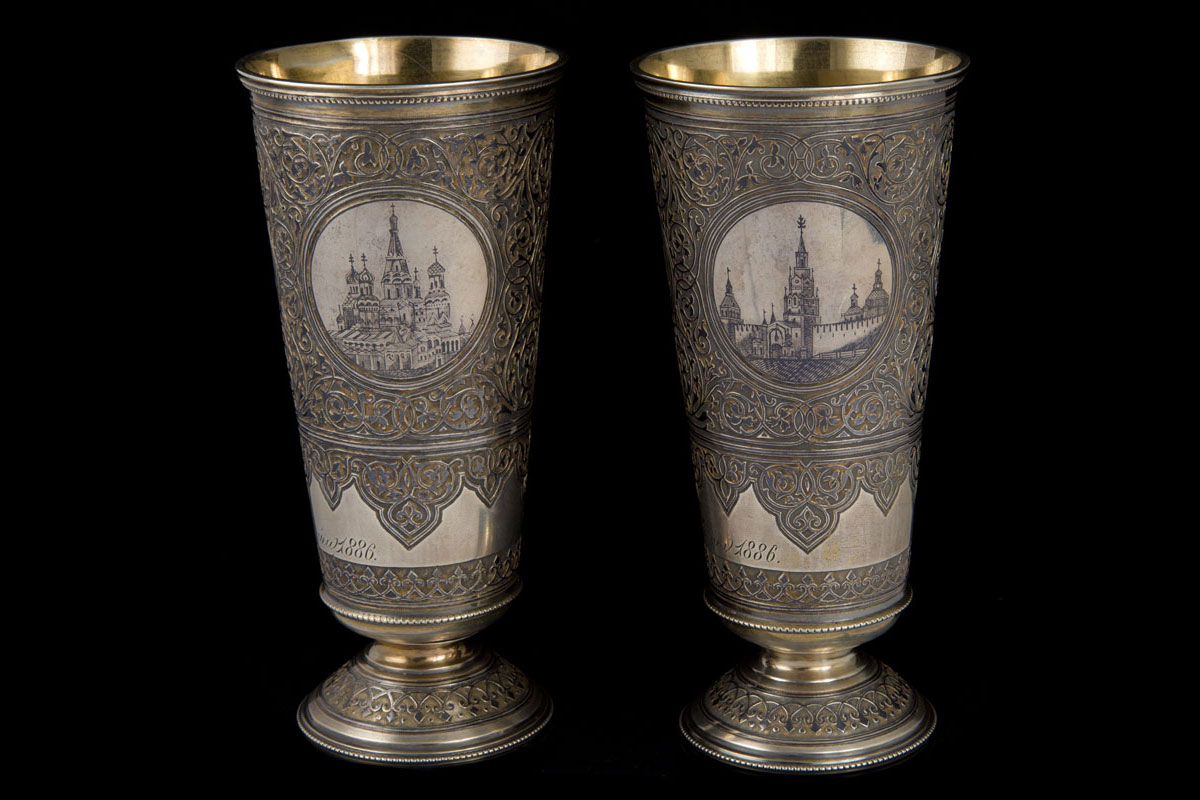 A pair of gild and niello silver wedding beakers, Moscow, 1886, by Outchnikov